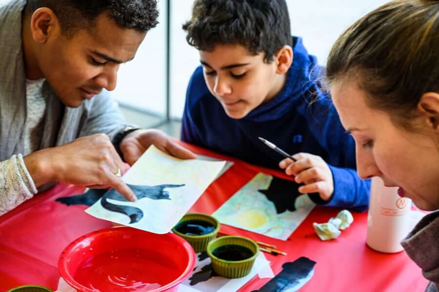 children painting at a table together