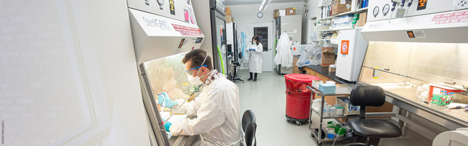 Researchers working on COVID-19 test kits at the State Lab of Hygiene (Photo by John Maniaci)