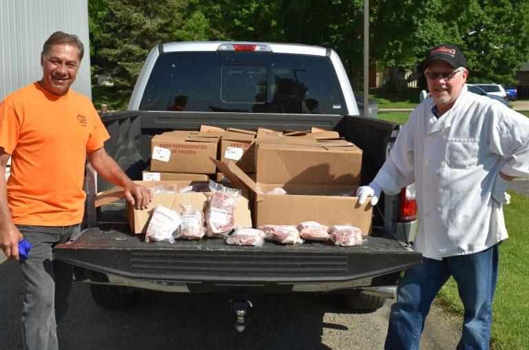 UW-Madison and Vita Plus representatives with donated meat